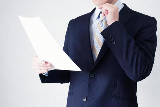 Businessmen who check documents