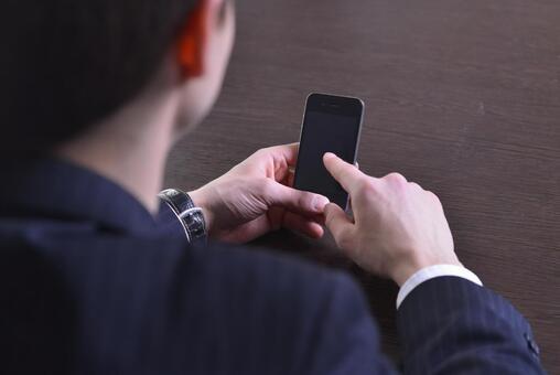 Businessman operating a smartphone 1