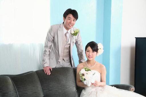 Bride and bridegroom sitting on the sofa 6