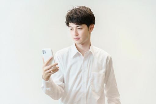 A man staring at a smartphone