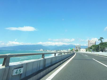 Drive along the sea in the blue sky