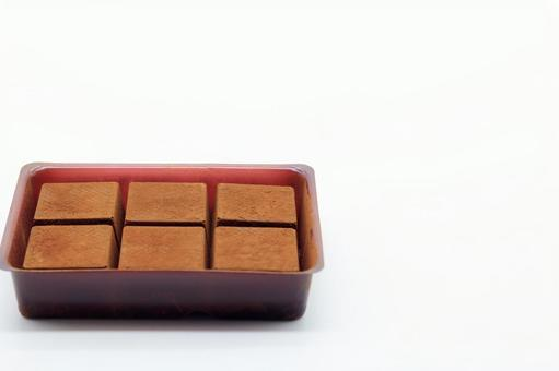 Raw chocolate lined up in a container
