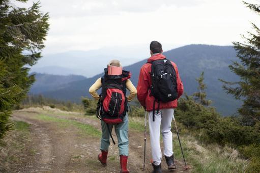 Trekker's couple walking on the mountain path 10