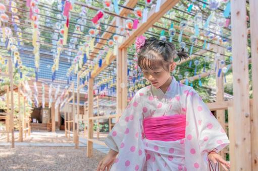 Girl in a wind chime and yukata