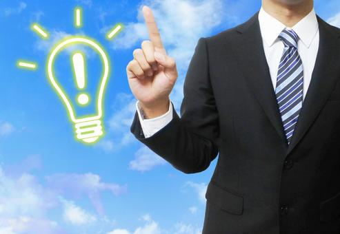 """""""Inspired · Point"""" image and a man in a suit (blue sky background)"""