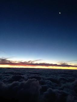 Sunrise from Mt. Fuji, moon and sea of clouds
