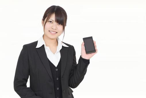 A woman with a smartphone