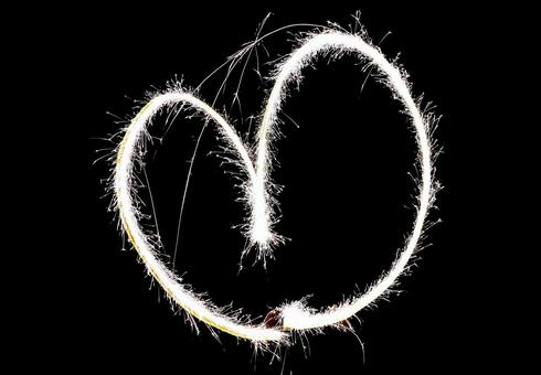 Heart drawn with fireworks