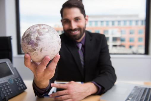 Office worker touching the globe 9