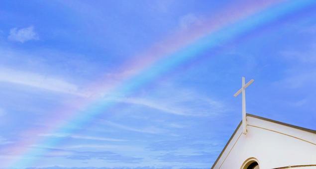 Rainbow and church over the clear sky