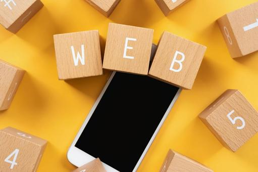 """Web   Building blocks and smartphones with """"WEB"""" written on them"""