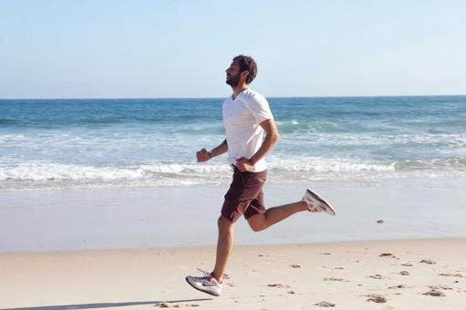 Foreign male running on the beach 17