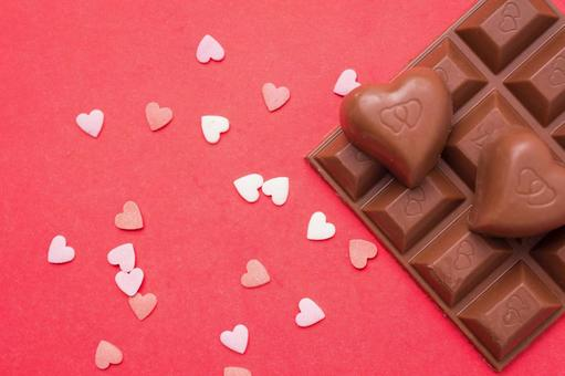 Red background Valentine 's chocolate 2