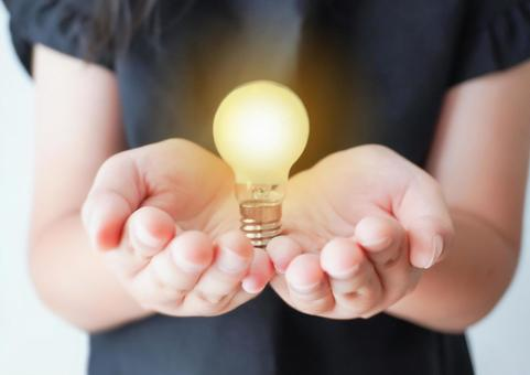 Image of child's palm and light bulb