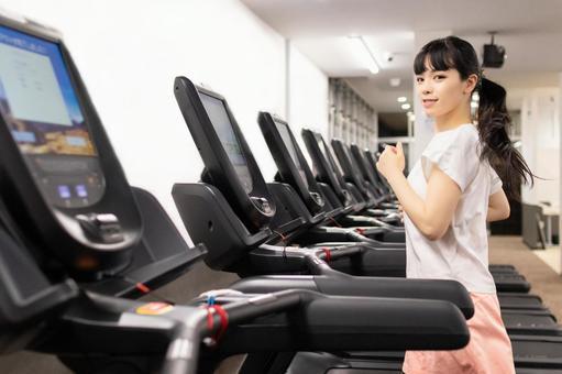 Woman running on running machine 3