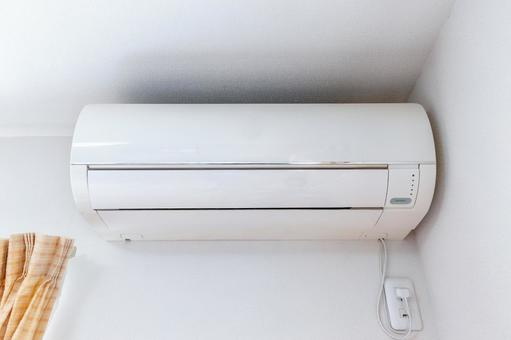 White air conditioner installed in the corner of the room
