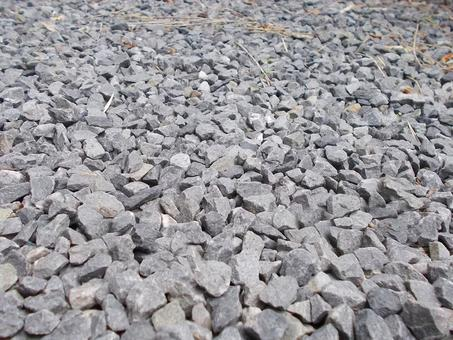 Spread crushed stone on one side