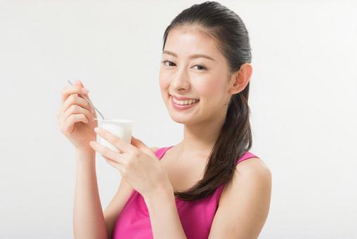 A woman eating yogurt 1