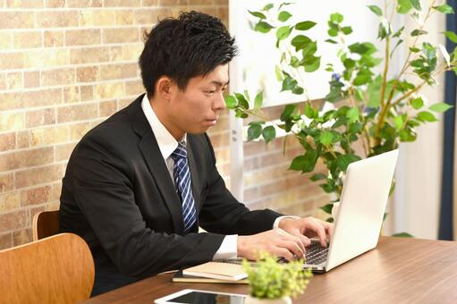 A businessman working on a personal computer
