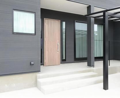 Black exterior porch with concrete terrace