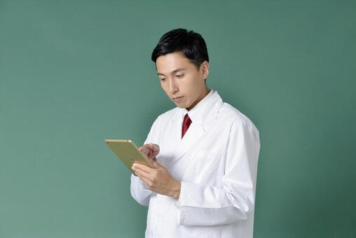 Male in white coat to operate iPad 2