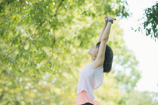 A woman who takes a deep breath while exercising