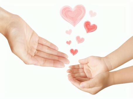 Parent and child hands and hearts