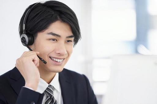 Call center man responding with a smile