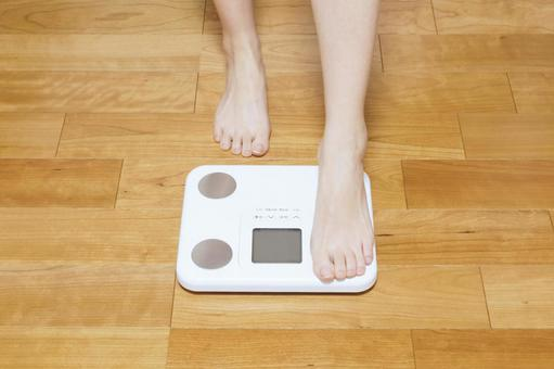 Woman trying to weigh