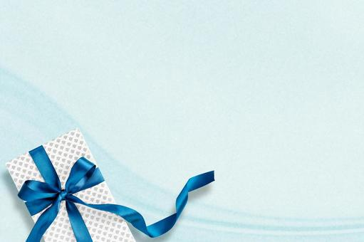 Present of blue ribbon on light blue drape background