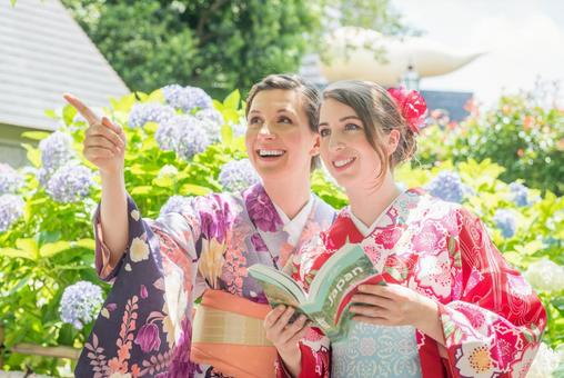 A guide book in front of hydrangeas Yukata women Foreign tourists 2