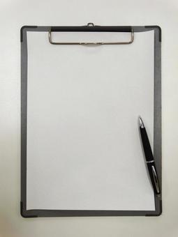 Clipboard and writing instrument