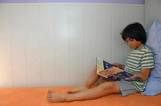 A Spanish boy who sits and reads books 2