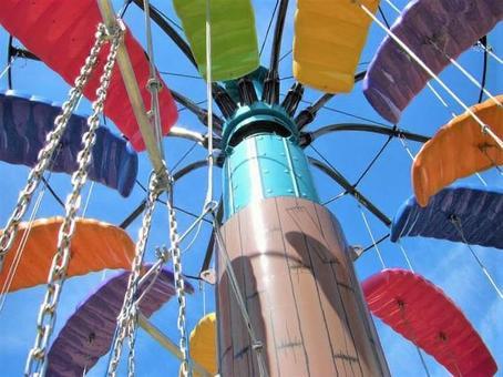 Colorful trapeze rides in the amusement park