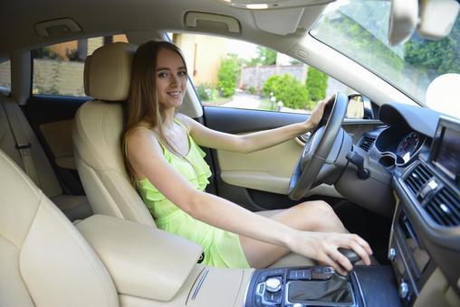 A woman driving a car 35