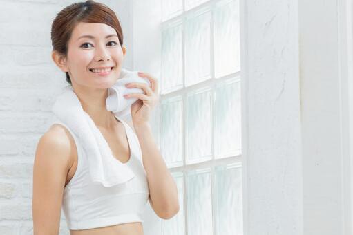 Sportswomen wiping sweat