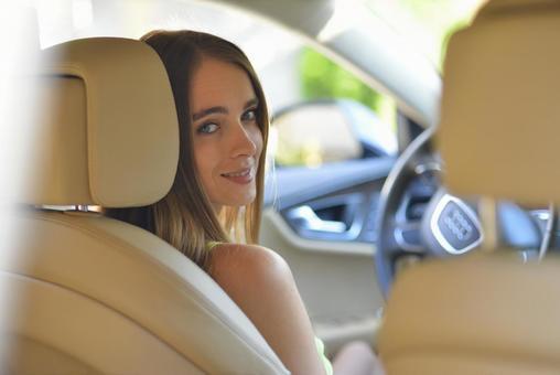 A woman driving a car 29
