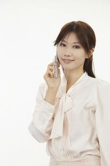 A woman with a cell phone