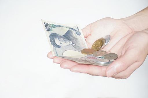 1000 yen bill, coins and both hands
