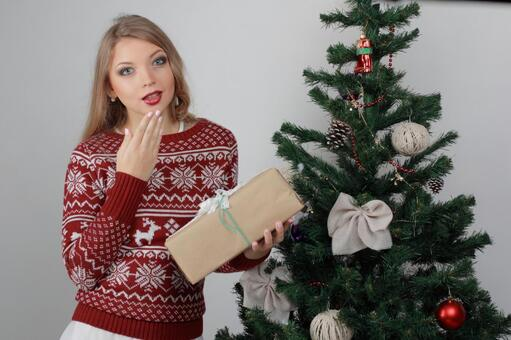 Female with Christmas tree and present 8
