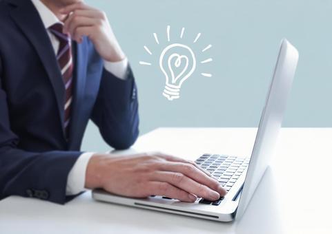 PC operating businessman and light bulb illustration