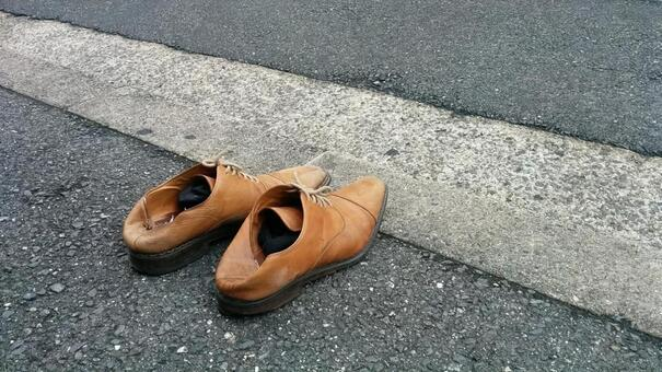 Leather shoes aligned on the road