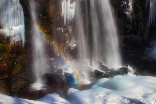 Karasawa waterfall and rainbow in winter