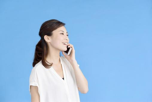 A woman who speaks on a smartphone 1