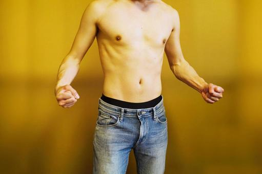 A man posing with muscle muscles