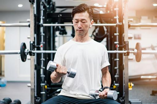 A man doing muscle training with dumbbells