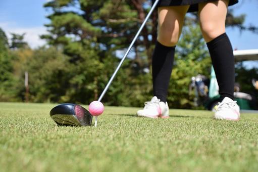 Golf girls tee shot