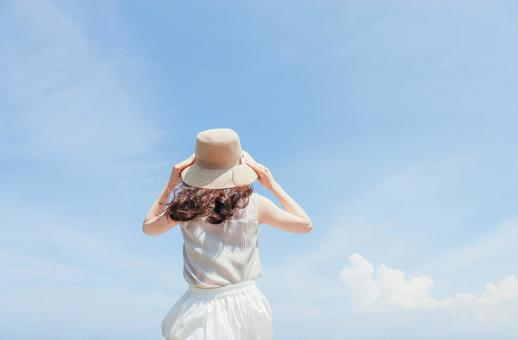 Woman looking at the blue sky