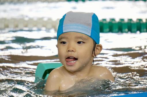 Children practicing swimming