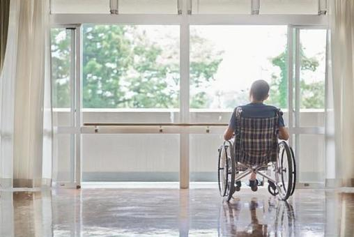 Elderly people in wheelchairs in long-term care facilities